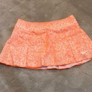 Fluorescent orange and white Nike tennis skirt